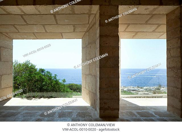 Can Lis, Mallorca, Spain. Architect: Utzon, Jorn, 1971. Living Room with frameless windows and view of sea