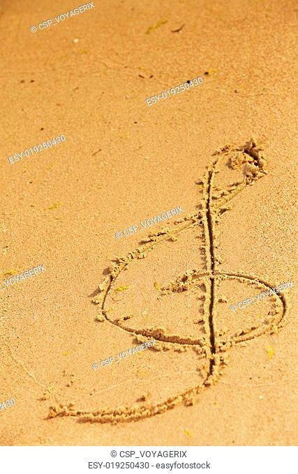Violin key treble clef drawn in sand