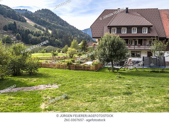 Black Forest houses and forest hills in the Southern Black Forest, spa health Menzenschwand, Germany, farm building High Black Forest near St