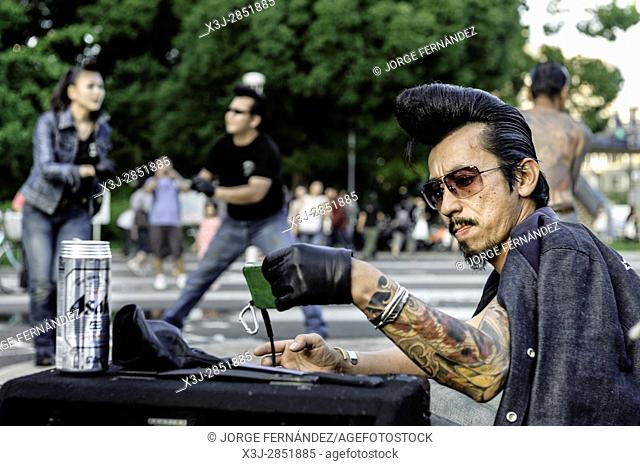 Group of people that gathers every weekend in Yoyogi park in Tokyo. They dress and dance rockabilly