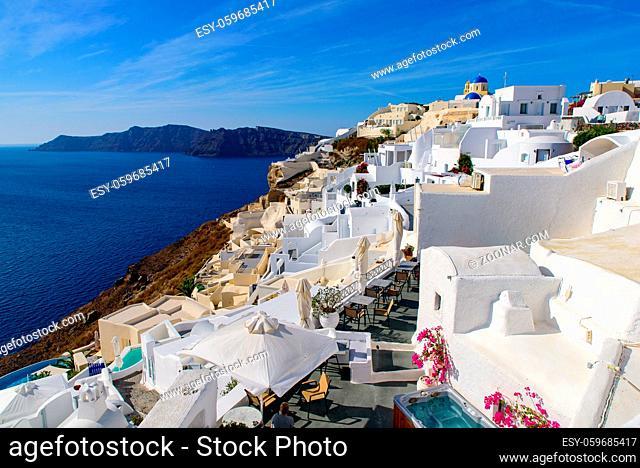 Traditional white buildings facing Aegean Sea in Oia, Santorini island, Greece