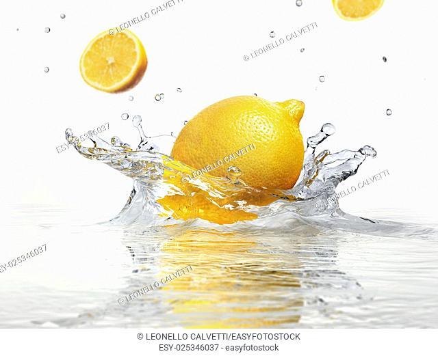 lemon splashing into clear water on white background