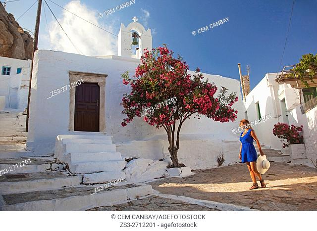 Woman near a chapel in Chora, Amorgos, Cyclades Islands, Greek Islands, Greece, Europe