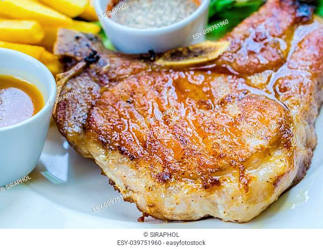 Pork chop steak on wood table
