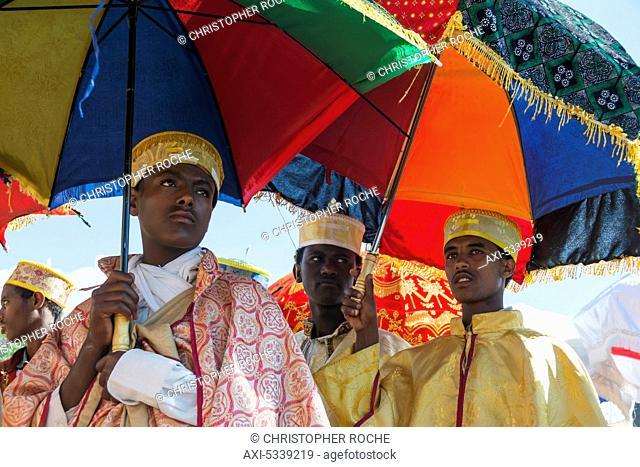 Ethiopian Orthodox Christian pilgrims with colourful umbrellas; Lalibela, Ethiopia