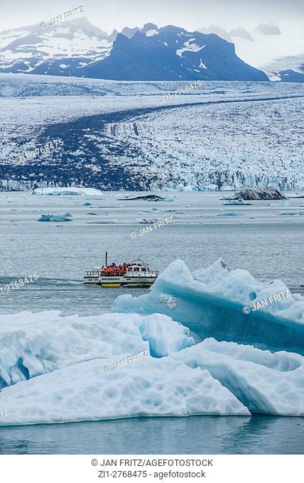 tourists in a boat at Jokulsarlon glacier lake in Iceland