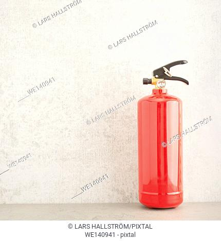 Fire extinguisher still life. Concept of fire prevention, safety equipment and home security
