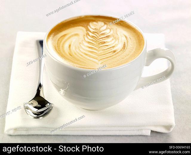 Latte in a White Mug; Spoon; On White Napkin