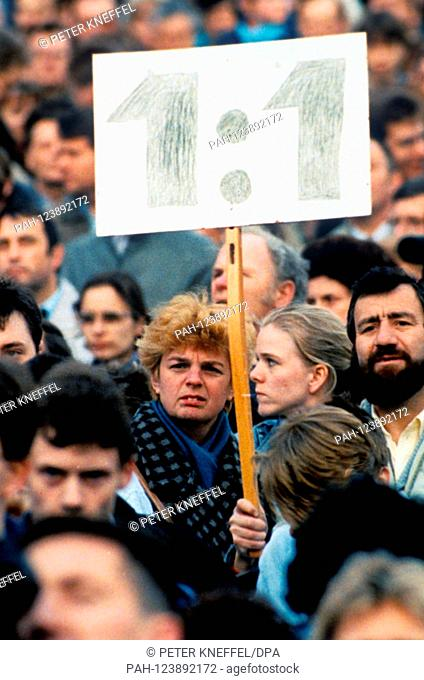 At a demonstration in East Berlin (GDR) on April 5, 1990, about 100,000 GDR citizens demand an exchange rate of their money at a ratio of 1:1 (East German Mark...