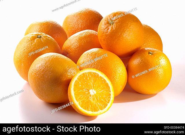Several oranges and an orange half