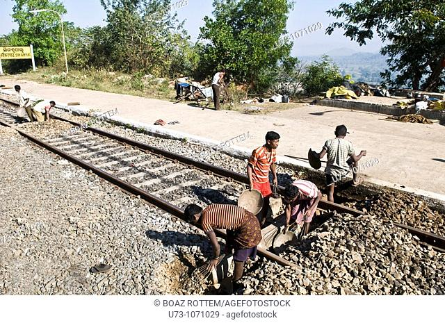 Fixing the railway track in a train station in Orissa, India