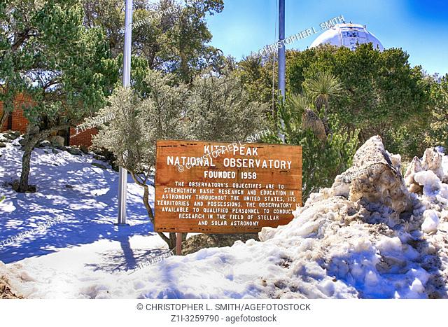 Kitt Peak National Observatory in Arizona wooden sign surrounded by snow