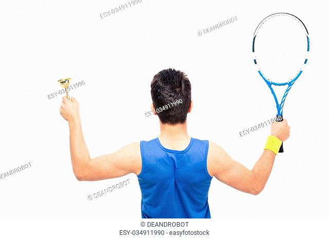 Back view portrait of a man holding tennis racket and cup isolated on a white background
