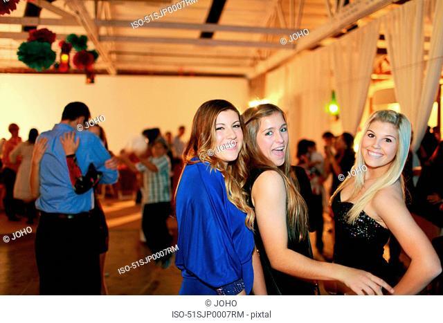 Teenage girls dancing at birthday party