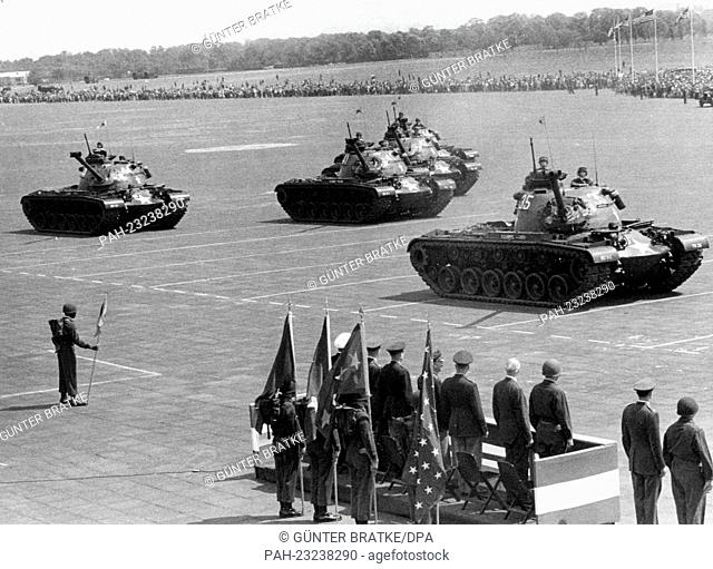 American tanks passing a VIP stand during a parade on occasion of the 'Armed Forces Day' at airport Tempelhof in Berlin on 17th May 1958