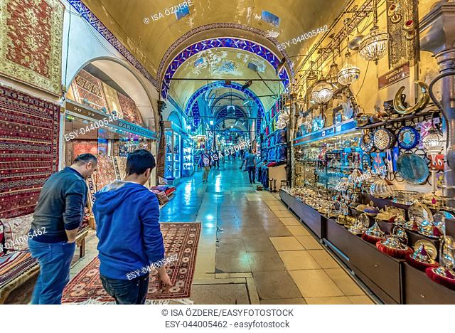 Unidentified people visiting the Grand Bazaar for shopping,Interior of the Grand Bazaar with souvenirs in Istanbul, Turkey. April 17, 2017