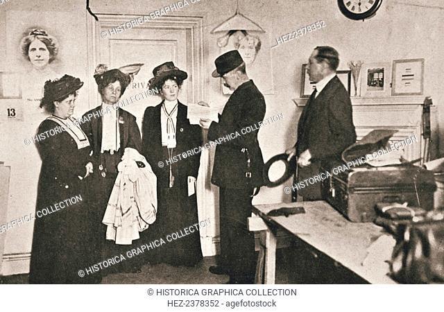 Arrest of leading suffragettes, London, 13 October 1908. Emmeline Pankhurst (1858-1928), Christabel Pankhurst (1880-1958) and Flora Drummond (1878-1949) being...