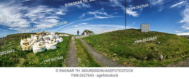 Bags of grass and dirt, pathway, Flatey Island, Breidafjordur, Iceland