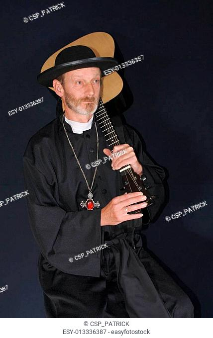 priest with guitar