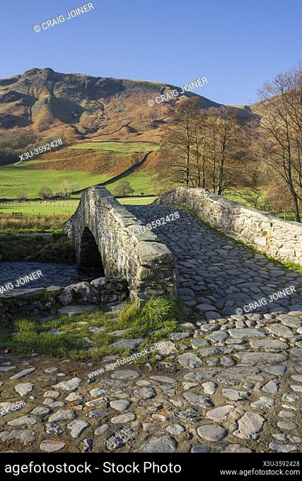 New Bridge over the River Derwent near Rosthwaite in the Lake District National Park with High Scawdel fell beyond, Cumbria, England