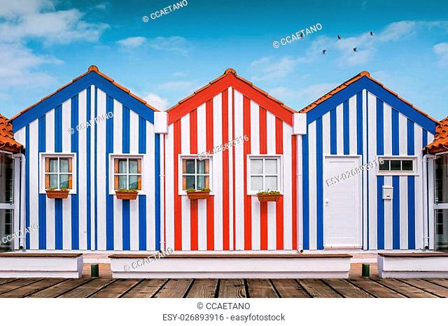 Typical small wooden houses with colorful stripes in Costa Nova neighborhood, Aveiro, Portugal