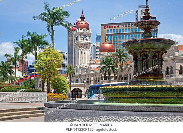 Merdeka Square showing fountain and the clock tower of the Sultan Abdul Samad Building in the city Kuala Lumpur, Malaysia