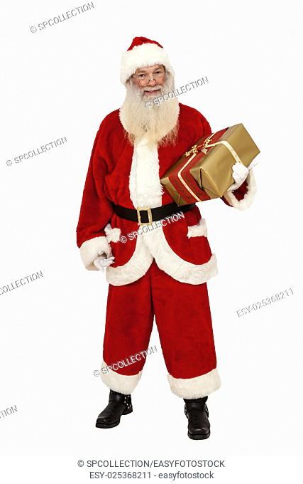 Santa Claus with real beard holding a gift in hand (isolated)