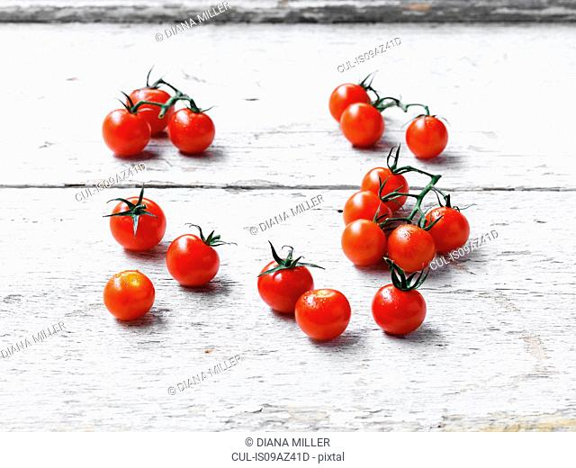 Cherry tomatoes whitewashed wooden surface