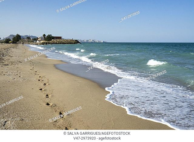 Footprints in the sand of an idyllic beach in Cullera, Valencia, Spain