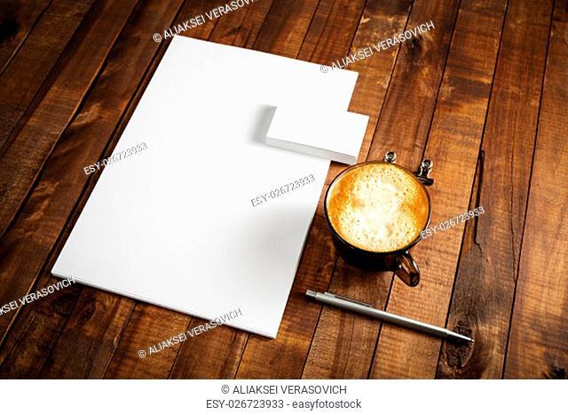 Photo of blank stationery set on vintage wood table background. Template for design portfolios. Mock-up for branding identity for designers