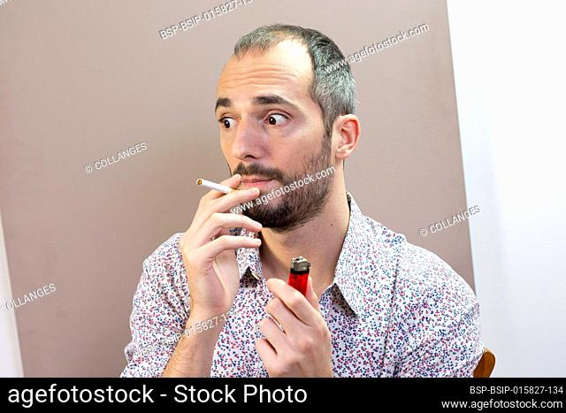 A man who is tempted to smoke again having given up smoking