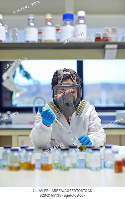 Researcher with protective mask. CO2 capture plant. Laboratory. Energy and Environment Division. Tecnalia Research and Innovation. Miñano. Alava