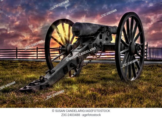 Gettysburg Battlefield Cannon - Dramatic skies as the sun sets behind a cannon from the 1863 Battle of Gettysburg American Civil War