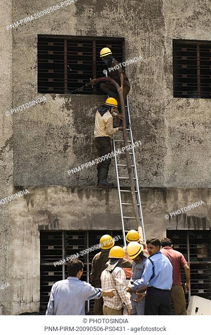 Firefighters during a rescue operation, Gurgaon, Haryana, India