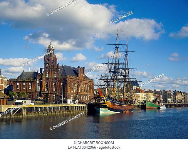 Town hall. Captain Cook's ship Endeavour moored. Masts. Cargo boat. Tallship. Tall ship