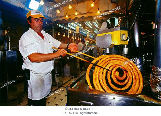 Baker of churros at a fair in the evening, Feria del Caballo, Jerez de la Frontera, Province of Cadiz, Andalusia, Spain, Europe