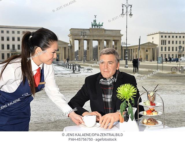 The wax figure of George Clooney from Madame Tussaud's sits in the cafe at Hotel Adlon near the Brandenburg Gate in Berlin, Germany, 23 January 2014