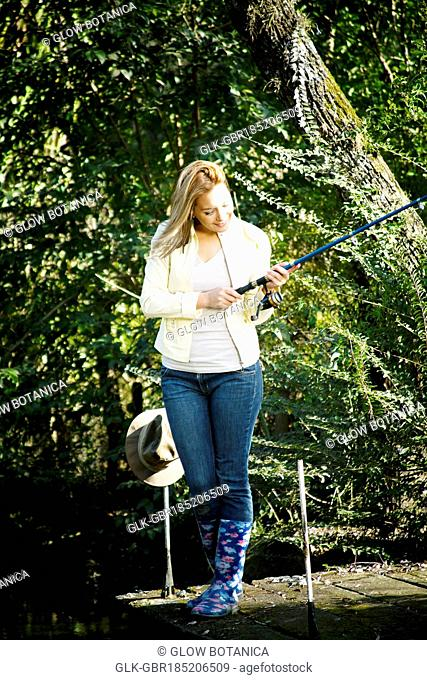 Woman fly-fishing in a river
