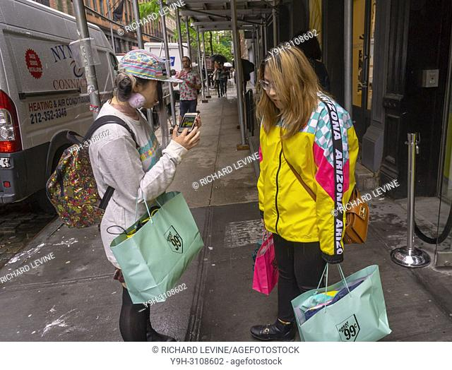 """Fans of AriZona Beverages flock to their """"""""Great Buy 99¢"""""""" pop-up store in Soho in New York on opening day, Wednesday, May 16, 2018"""