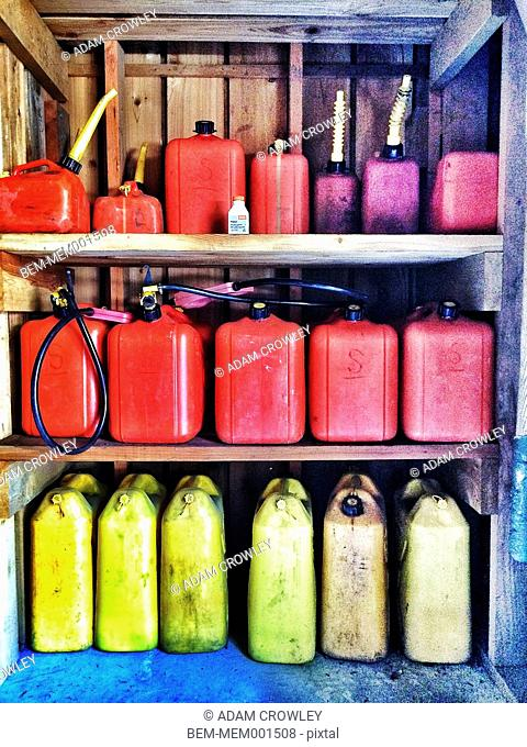 Multicolor gas cans on shelves