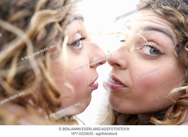 perturbed woman facing herself