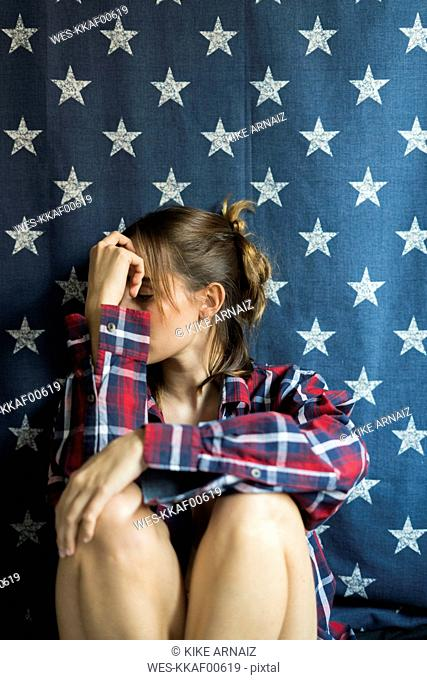 Young woman in front of star-shaped background