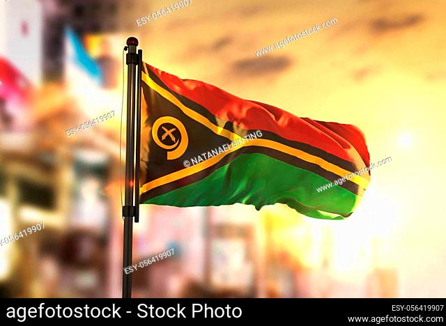 Vanuatu Flag Against City Blurred Background At Sunrise Backlight