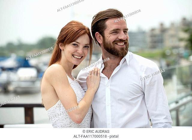 Couple standing together outdoors