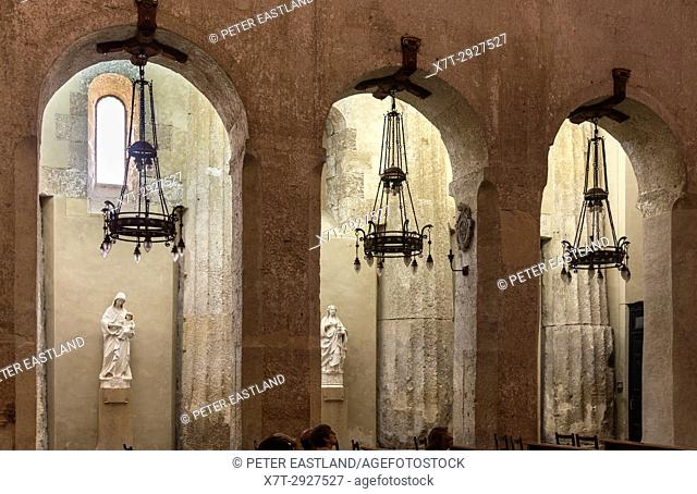 Interior of Syracuse Duomo showing doric columns from the original ancient Greek temple, Sicily, Italy