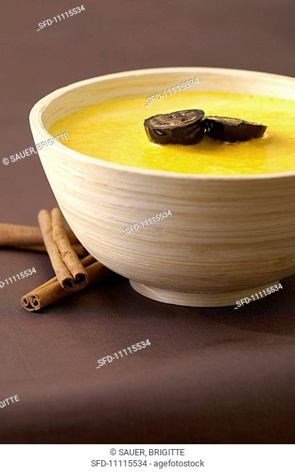 Pumpkin soup with black nuts