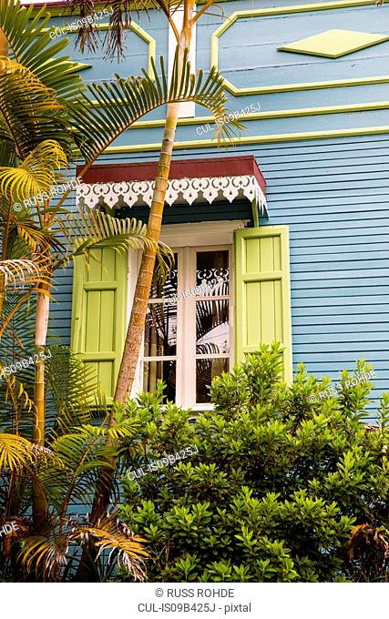 Traditional wooden grey house exterior with shutters, Reunion Island
