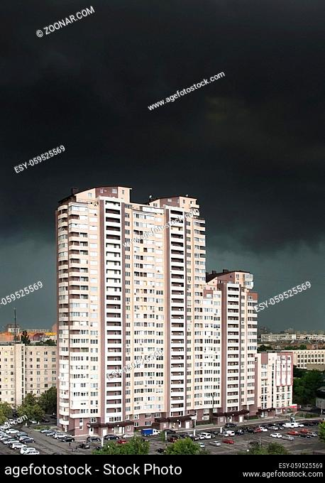Apartment building under the black stormy clouds