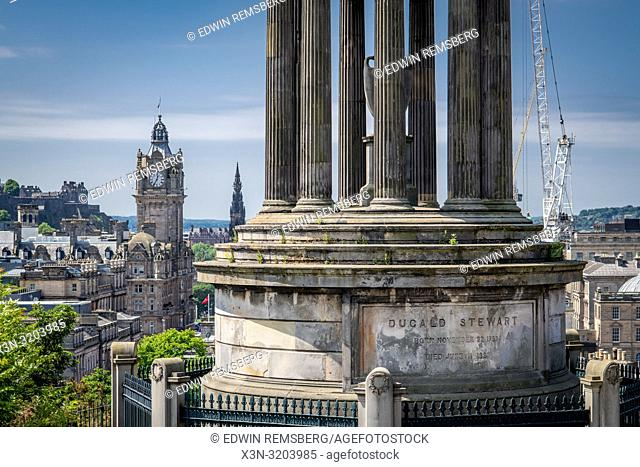 The Greek inspired memorial to Dugald Stewart rests on Calton hill with the Balmoral hotel in the background, Edinburgh, Scotland, UK
