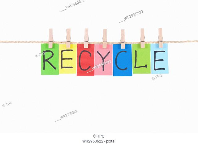 Recycle, paper words card hang by wooden peg